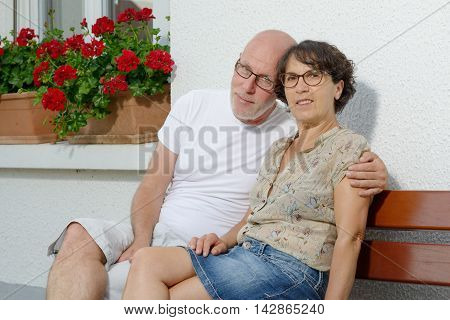 a portrait of a couple of seniors in the garden