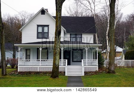 WEQUETONSING, MICHIGAN / UNITED STATES - DECEMBER 22, 2015: An elegant white Victorian home on Pennsylvania Avenue in Wequetonsing.