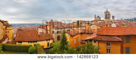 Panoramic aerial view of Medieval Upper town Citta alta of Bergamo with towers and churches in nasty cloydy day, Lombardy, Italy