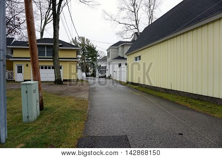 WEQUETONSING, MICHIGAN / UNITED STATES - DECEMBER 22, 2015: An alley with garages, behind homes in Wequetonsing, Michigan.