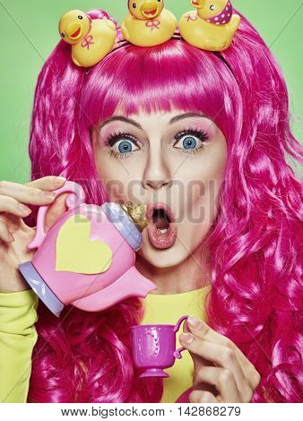 Girl doll with pink hair with different emotions. Anime style. Candies and toys.