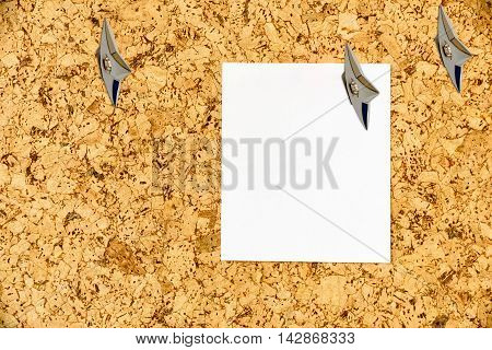 Empty sheet of paper attached on a cork bulletin board with Japanese ninja concealed weapons. Copy space for leaving several messages i.e. general information advance informationrecommendation etc