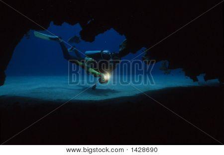 Scuba Diver Exploring A Cave
