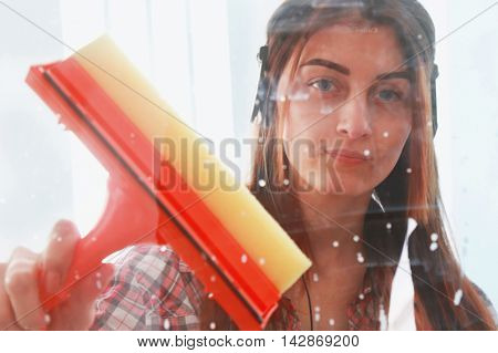 beautoful woman at work professional female cleaner cleaning and wiping window in office
