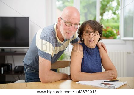 a portrait of a senior couple in their home