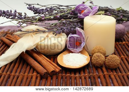 Aromatherapy - spa objects and violet flowers