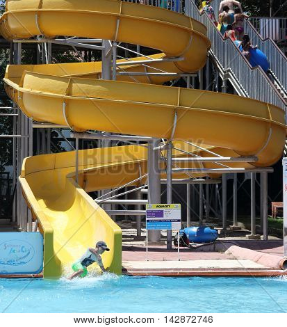18TH JULY 2016, CALIS,TURKEY; A young boy having fun on the water slides at an aqua park in Calis in Turkey,18th july 2016
