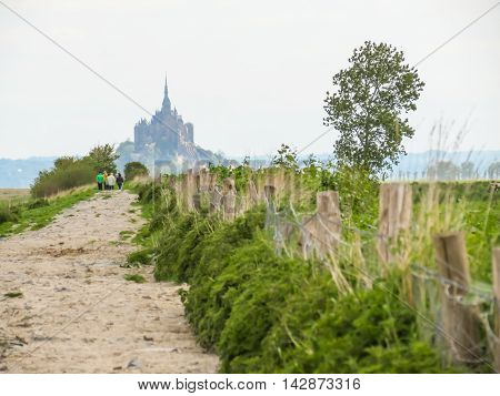 Road to Mont Saint-Michel - tidal island town and abbey. France
