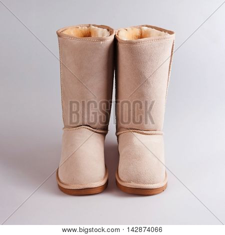 female Fashion winter boots in grey background