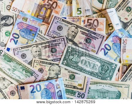 Euro banknotes and American dollar bills