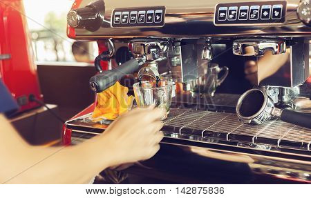barista young woman hand and speed making a Coffee coffee with an coffee machine hustle at coffee shop