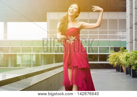 Happy And Cheerful Asian Woman In Good Mood Dancing On Rooftop Of The Building