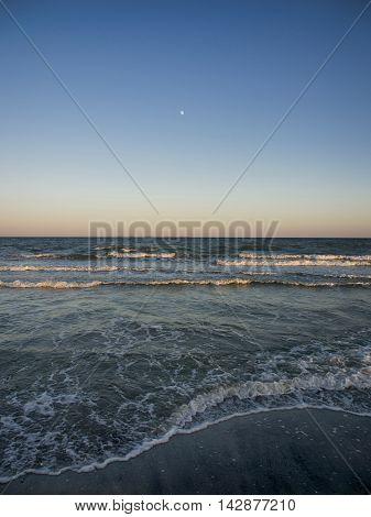 Moon rise over the virgin beach of Vadu, Constanta county, Romania