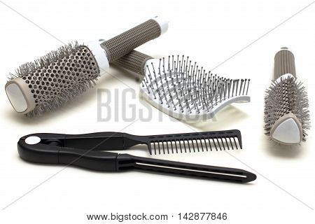 black and gray Hairbrushes on white table