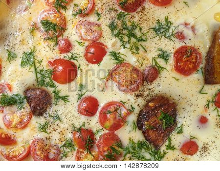 Summer food background - omelette with with cherry tomatoes and aubergine