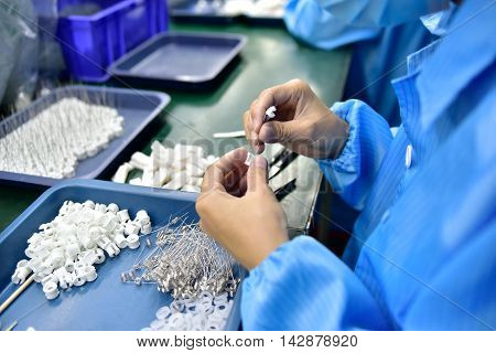 View on the worker's hands dealing with small details