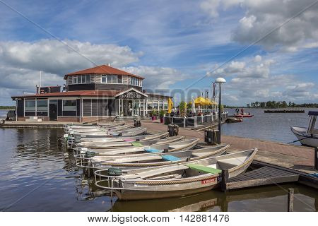 GIETHOORN, NETHERLANDS - AUGUST 9, 2016: Boats in front of a restaurant in Giethoorn, Holland