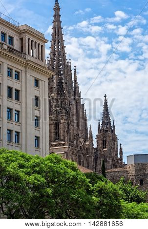 The steeple of the Cathedral of Barcelona in the center of Barcelona Spain.