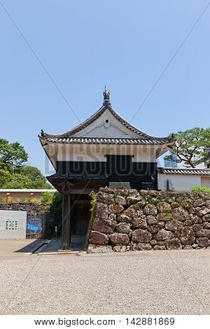 KOCHI JAPAN - JULY 19 2016: Side view of the Otemon (Main) Gate (circa 17th c.) of Kochi castle Shikoku Island Japan. Kochi is one of only 12 survived castles in Japan