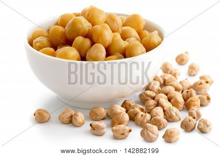 Cooked Chickpeas In White Bowl On White. Spilled Dry Chickpeas.
