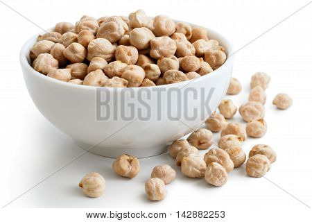 Dried Chickpeas In White Bowl On White. Spilled Chickpeas.