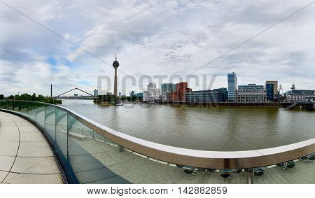 DUESSELDORF, GERMANY - JUNE 26, 2016: Panorama view on TV-Tower, marina and famous buildings at new media harbor of Duesseldorf, located at the river Rhine