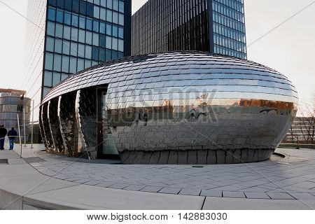 DUESSELDORF, GERMANY - FEBRUARY 27, 2016: Famous Chrome Egg building in Duesseldorf Media Harbor with hotel tower in the background