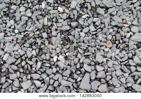 Texture of a gray walkway of gravel and crushed stones