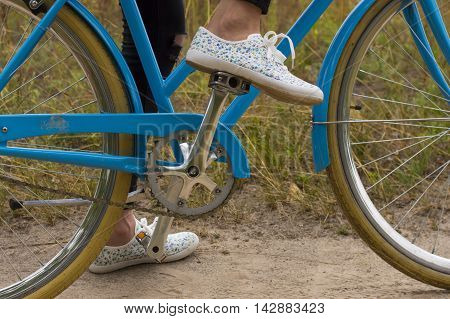 Close up of Young Woman Riding Vintage Bicycle in Forest