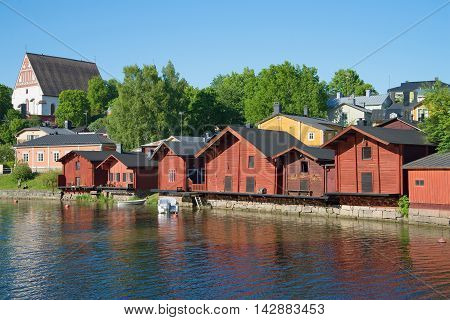 PORVOO, FINLAND - JUNE 13, 2015: Quay of the old city june evening. The boat is at the dock at the old barns. Historical landmark of the city Porvoo, Finland