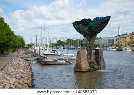 TURKU, FINLAND - JUNE 13, 2015: June day on the river Aura. The view of the fountain