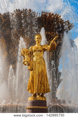 Detail of Fountain Friendship of nations in Moscow at ENEA - sculpture of girl symbolizes Russia. Architect Topuridze, sculptors Bazhenova, Chaikova, Ryleeva. Russia Moscow. August 16, 2016