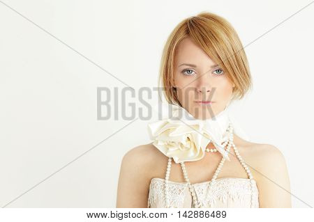 Fashion beautiful girl with bob haircut and flowers