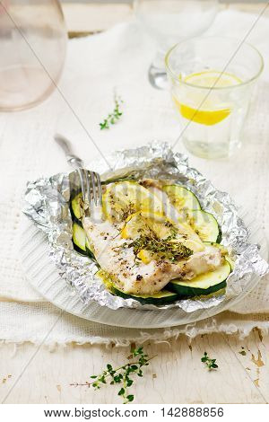 the baked cod with zuccini . selective focus