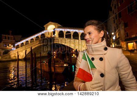 Woman With Italian Flag Having Fun Christmas Time In Venice