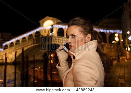 Woman Talking Cellphone While Spending Christmas Time In Venice