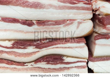 Texture of bacon close-up lying beside and one above the other