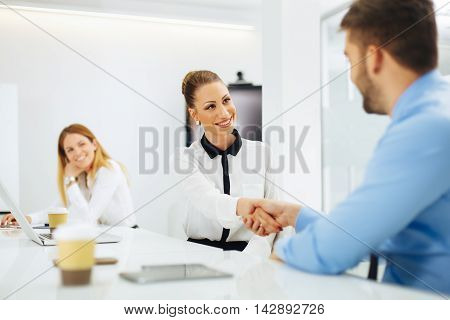 Business people shaking hands after a successful agreement
