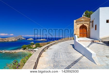 beautiful house in Lindos on the background of the bay, yachts and ships