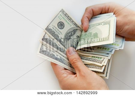 Close up of male hands with money. US