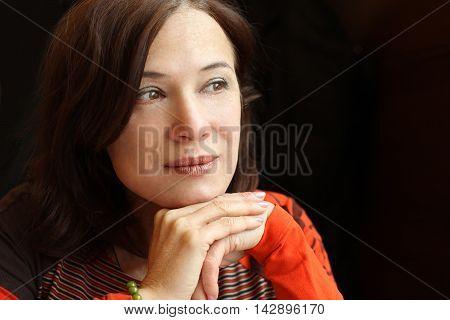Woman 40s - mature beauty on dark background
