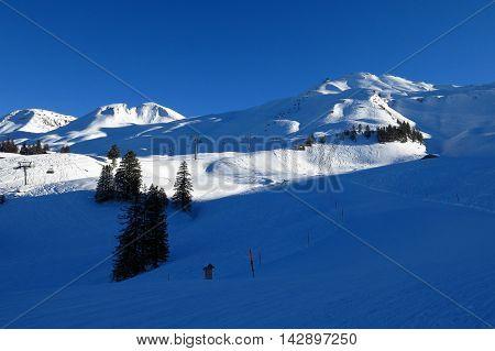 Ski slopes on Mt Klingenstock Stoos ski area. Evening scene.