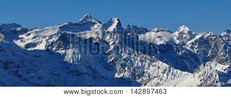 Winter scene in Central Switzerland. View from Klingenstock. Mt Uri Rotstock.