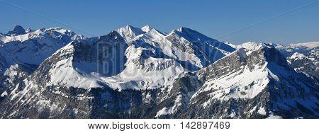 View from Mt Klingenstock Switzeland. Mt Schwalmis and Mt Brisen in winter.