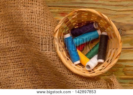Colorful Bobbins Of Thread In The Weaven Basket