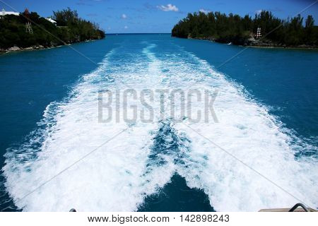 The water at the back of a boat as it travels into a harbor in St. George, Bermuda