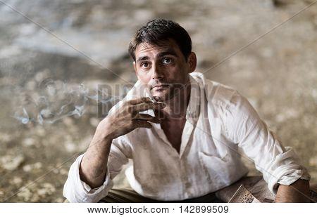 Dirty Working man enjoying his cigarette. Smoker