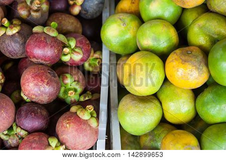 Mixed tropical fruits on local asian market in Thailand in fifty fifty proportion