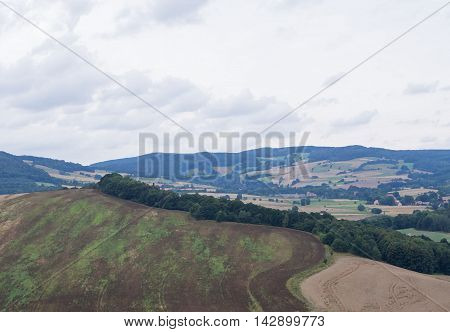 Beautiful hilly landscape with field and trees in Silesia as painting Poland