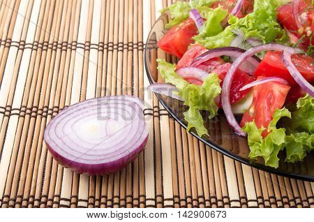 Closeup View On A Fragment Of A Translucent Plate With A Fresh Salad